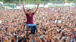 Man in wheelchair celebrates at a concert